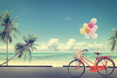 Vintage Bicycle with Balloon on Beach
