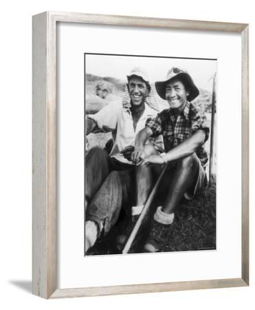 Edmund Hillary and Nepalese Sherpa Guide Tenzing Norgay Sitting Together