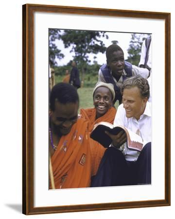 Evangelist Billy Graham Showing His Bible to the Waarusha Warriors Near Mt. Meru