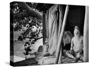 Hindu Holy Man Sitting in His Home by James Burke