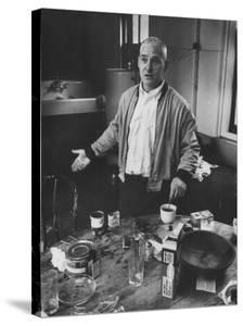 Willem de Kooning Preparing to Drink a Cup of Coffee in His East 10th St. Studio by James Burke