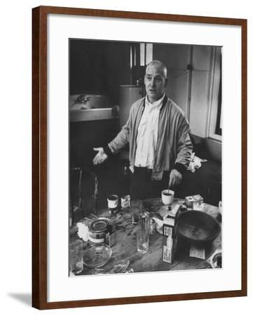 Willem de Kooning Preparing to Drink a Cup of Coffee in His East 10th St. Studio