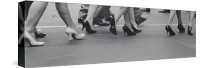 Women Walking on the Street in Spike Heeled Shoes