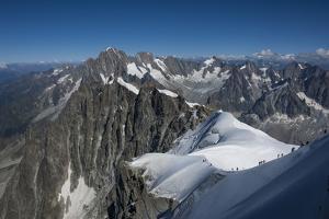 Climbers on a snowfield approaching the Aiguile du Midi, 3842m, Graian Alps, Chamonix, Haute Savoie by James Emmerson