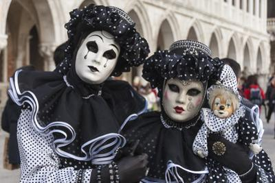 Couple in Black and White with Clown Puppet, Venice Carnival, Venice, Veneto, Italy, Europe