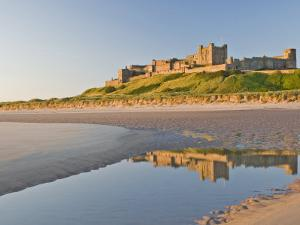 Morning Light on the Beach at Bamburgh Castle, Northumberland, England, United Kingdom, Europe by James Emmerson
