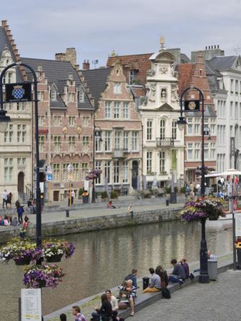 Students Relaxing Along Banks of Graslei, Ghent, Belgium