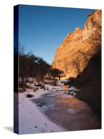 A Frozen Stream at Sunrise at the Foot of the Canyon De Chelly Cliffs