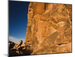 Ancient Native American Petroglyphs on Sandstone Cliffs by James Forte