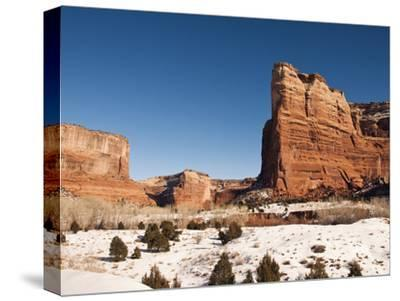 Cliffs and Rock Formations in a Snowy Canyon De Chelly Landscape