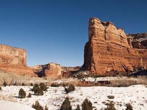 Cliffs and Rock Formations in a Snowy Canyon De Chelly Landscape by James Forte