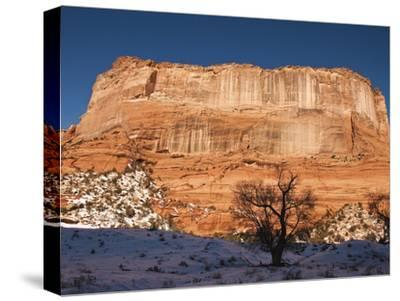 Large Plateau Rock Formation in a Snowy Canyon De Chelly Landscape