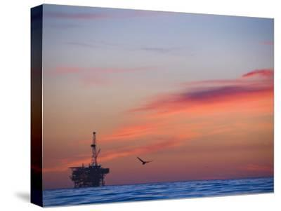 Offshore Oil and Gas Rig in the Pacific Ocean at Sunset
