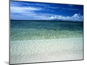 Secluded White Sands Beach on a Tropical Island with Blue Sky, Clouds by James Forte