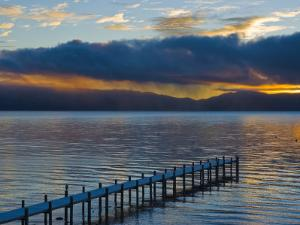 Snow Covered Pier on Lake Tahoe with Dramatic Sunrise Light by James Forte