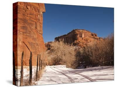 Tire Tracks in the Snow at the Canyon De Chelly Cliffs