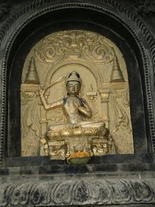 Close-up of Gold Relief Carving of Manjushri, Bodhgaya (Bodh Gaya), Bihar State, India, Asia by James Gritz