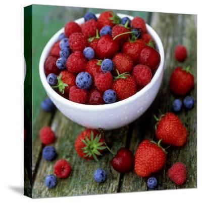Summer Fruit, Blackberries, Strawberries, Raspberries, Blueberries and Cherries on Rustic Table