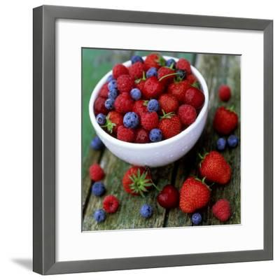 Summer Fruit, Blackberries, Strawberries, Raspberries, Blueberries and Cherries on Rustic Table