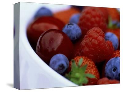 Summer Fruits in White Ceramic Bowl: Strawberries, Raspberries, Blueberries and Cherries
