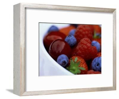 Summer Fruits in White Ceramic Bowl: Strawberries, Raspberries, Blueberries and Cherries
