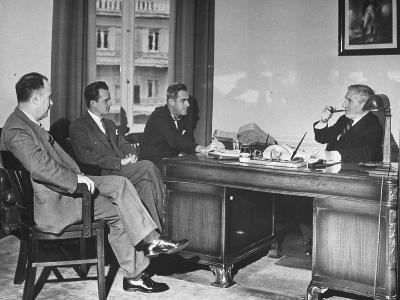 James H. Keeley, Oliver M. Marcy, Leonard J. Cromie and Lincoln Macveagh Having a Conference--Photographic Print
