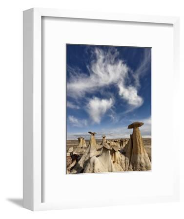 Yellow Hoodoos under a Wispy Cloud, San Juan Basin, New Mexico, USA, North America