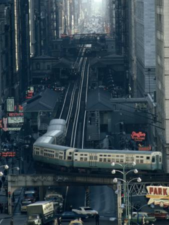 A Railway Encircles Thirty-Five Blocks of Shops, Offices, and Hotels by James L^ Stanfield