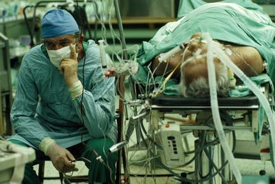 Dr. Zbigniew Religa Keeps Watch on a Monitor Tracking the Vital Signs of a Heart-Transplant Patient