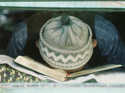 Student Sleeps with his Forehead Resting on his Book by James L. Stanfield