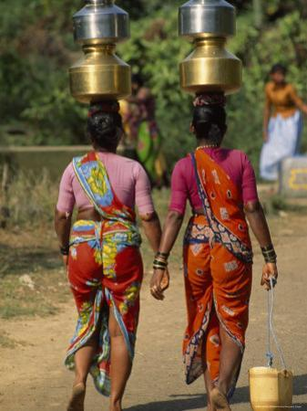 Women from Khilabandar Balance Containers of Water on their Heads by James L. Stanfield