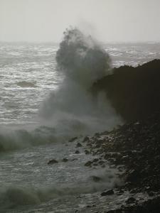 A Wave Splashes on the Shore of Tristan Da Cunha Island by James P. Blair