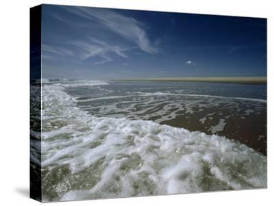 Atlantic Ocean Surf Washes the Sand Beneath a Blue Sky, Assateague Island, Virginia