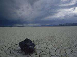 Cracked Desert Floor Spreads out for Miles under Dark Storm Clouds, Black Rock Desert, Nevada by James P. Blair