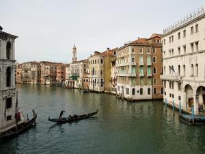 Gondolier Boating Through the Scenic Grand Canal in Venice by James P. Blair
