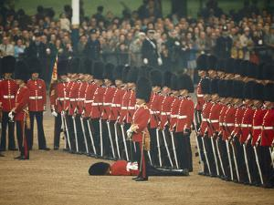 Irish Guards Remain at Attention after One Guardsman Faints by James P. Blair