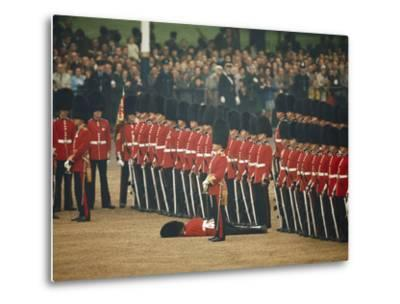 Irish Guards Remain at Attention after One Guardsman Faints