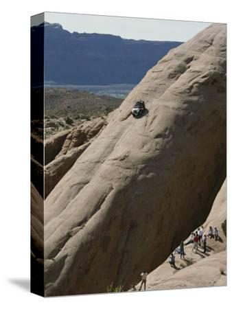 Jeep Drives Down a Slick Rock Formation Called Lion's Back, Utah