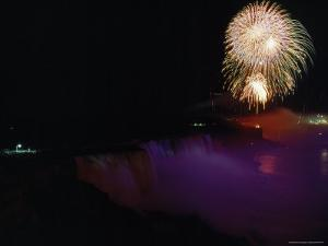 Memorial Day Fireworks Explode over the Dimly Lit American Falls by James P. Blair