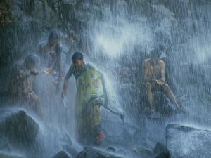 Pilgrims Bathe in the Narmada's 160-Foot-Tall Kadil Dhara Waterfall by James P. Blair