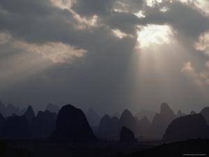 Sunlight Illuminates Limestone Peaks in a Karst Region near Guilin, Guangxi Province, China by James P. Blair
