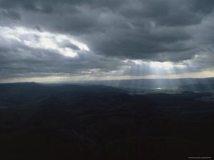Sunlight through the Clouds Illuminates a Valley, Spruce Knob, West Virginia by James P. Blair
