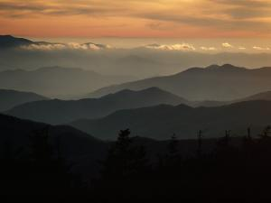 Sunset Casts a Colorful Glow over Mountaintops Shrouded in Fog by James P. Blair