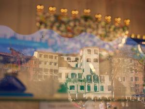 The Ghetto and Crowds Reflected in a Shop Window by James P. Blair