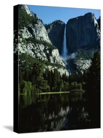 Yosemite Falls Behind a Still Lake, California