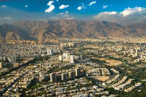 Aerial view of Tehran facing North towards the Alborz Mountains, Tehran, Iran, Middle East by James Strachan