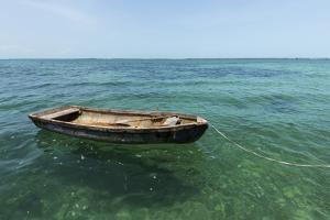 A Dingy Floats by Itself on Open Green Waters Near the Southern Coast of Cuba by James White