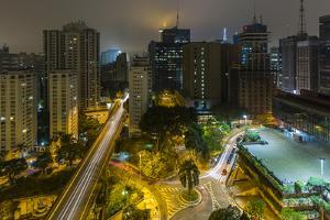 Long exposure night photography during a foggy night in downtown Sao Paulo, Brazil. by James White