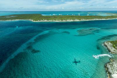 Looking Down at Airplane's Shadow, Jet Ski, Clear Tropical Water and Islands, Exuma Chain, Bahamas