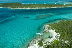 Looking Down at Airplane's Shadow, Jet Ski, Clear Tropical Water and Islands, Exuma Chain, Bahamas by James White